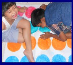 my children playing our improvised body twister game