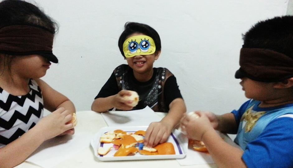 My kids were blindfolded while peeling their oranges, laughter everywhere!