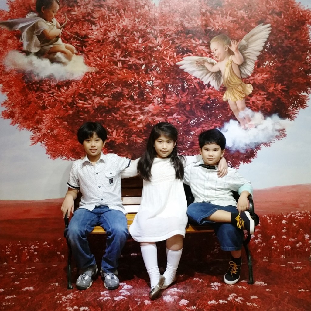 My kids sitting under the lovely cupid tree at the Live.Laugh.Love. zone